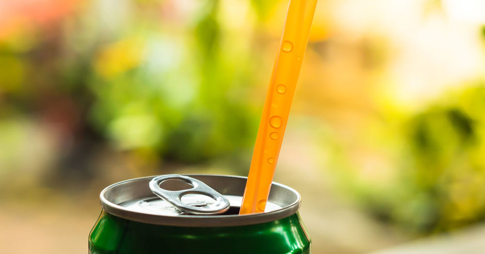 Close-up of straw in drink can
