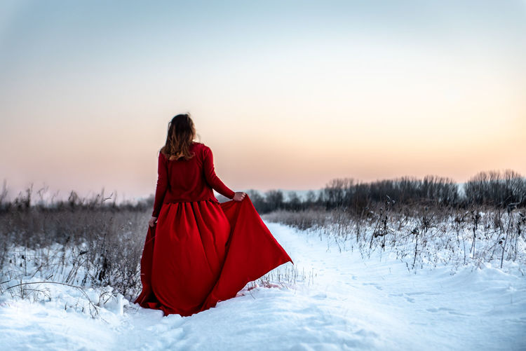 Morning Light White Background Copy Space Natural Snowy Cold Temperature Winter Snow Girl Woman In Red Red Dress Red Outdoors Nature Women One Person Beauty In Nature Field Rear View Scenics - Nature Fine Art