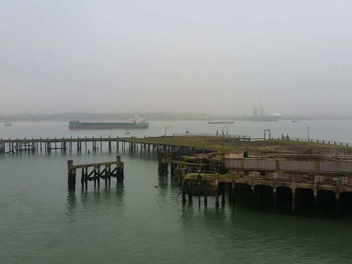 Southampton Docks United Kingdom Architecture Built Structure Day Dockside Fog Foggy Mode Of Transport Mode Of Transportation Nature Nautical Vessel No People Outdoors Pier Sea Ship Shipping  Ships Sky Southampton Tranquility Transportation Water Waterfront