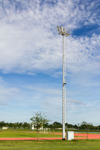 Low angle view of floodlight on field against sky