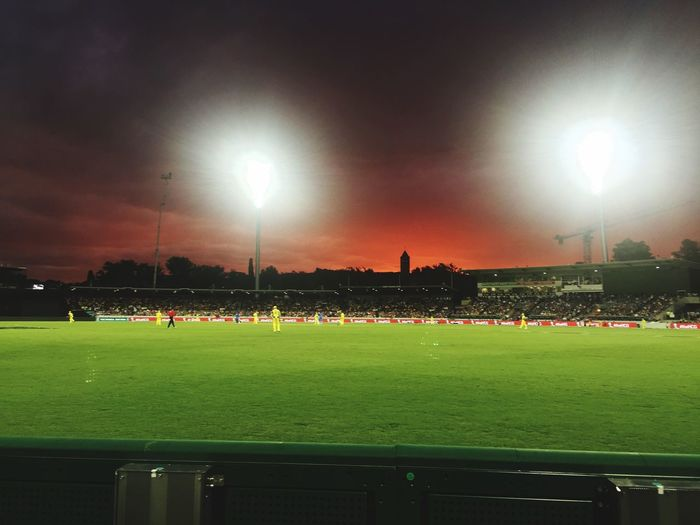 India Vs Australia Cricket Match Red Sky Sport Grass Soccer Crowd Team Sport Sky Floodlight Stadium Green Color Playing Field Outdoors Illuminated