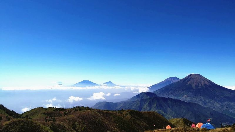View from the top of Mount Prau is really beautiful Photography Image Camping Mountain Prau Mountainview Praumountain Beautiful Good Morning City Volcanic Landscape Volcano Sky Mountain Range Landscape Mountain Peak Foggy Mountain Ridge