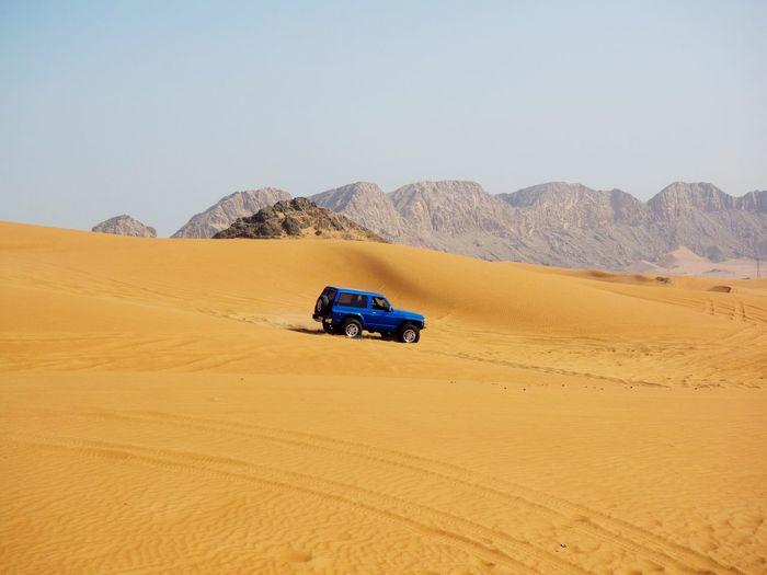 Off-Road Car At Desert Against Sky