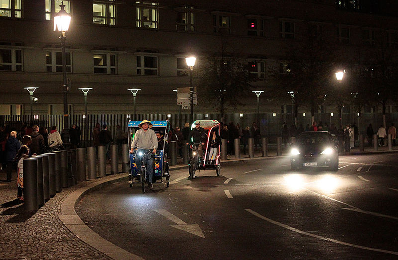 rikshaw taxis in Berlin Bicycle Celebrate Your Ride City City Life City Street Enjoyment Fun Land Vehicle Lights Motion Night Rikshaw Road Street Taxi Transportation Urban