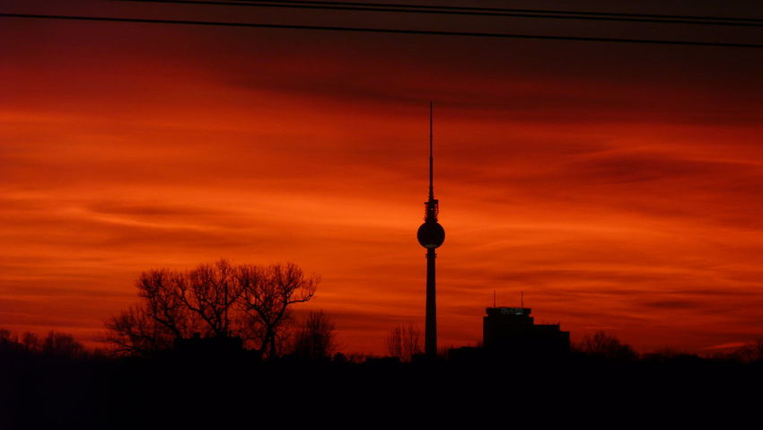 Architecture Built Structure Sunset City Tower Television Tower Night Outdoors Travel Destinations Communication Silhouette Neighborhood Map Live For The Story The Street Photographer - 2017 EyeEm Awards EyeEm Selects EyeEmNewHere Neon Life Berliner Ansichten Berlin Photography Investing In Quality Of Life Love Berlin❤ Discover Berlin