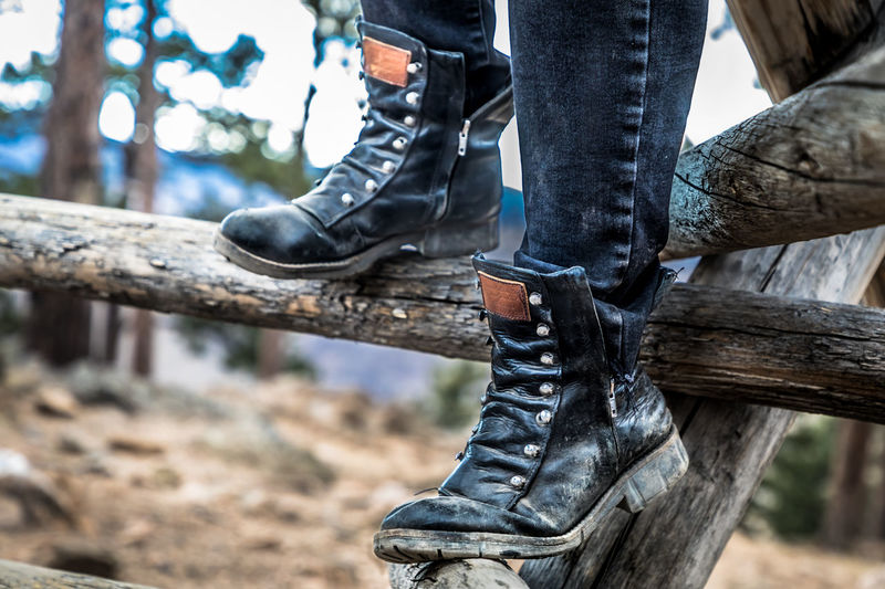 Low Section Human Leg Human Body Part Body Part Shoe One Person Real People Tree Focus On Foreground Day Men Casual Clothing Jeans Lifestyles Leisure Activity Boot Nature Outdoors Wood - Material Human Foot Human Limb