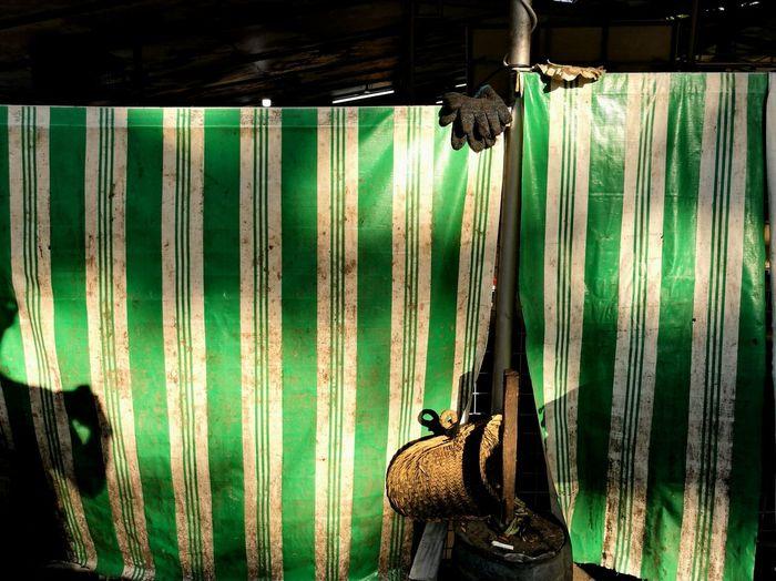 Close-up of illuminated lighting equipment hanging against window