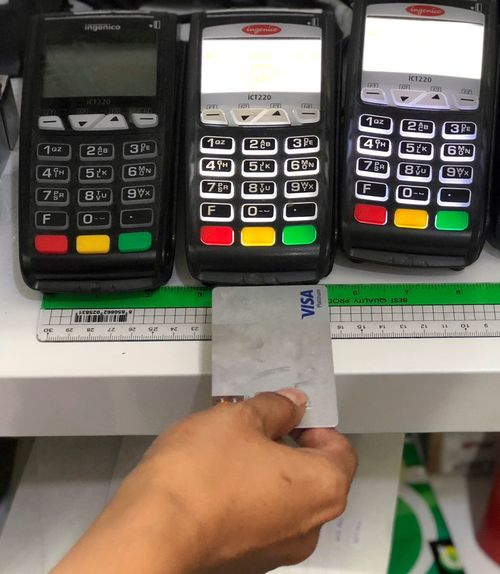 Using credit card in department store Human Hand Human Body Part Hand Technology Number Lifestyles One Person Holding Real People Close-up Finance Leisure Activity Indoors  Finger Personal Perspective Body Part Machinery Human Finger Communication Keypad