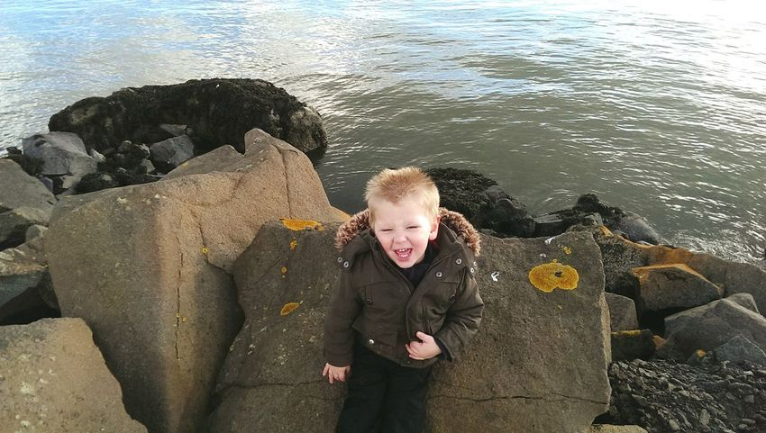 MyBoy Myson Laughter Laughing Outforawalk Sea View Seaside Sea Sitting Outside Sittingontherocks Happiness Happy Taking Photos Hanging Out Point And Shoot Outdoor Photography Walking Around Hanging Out