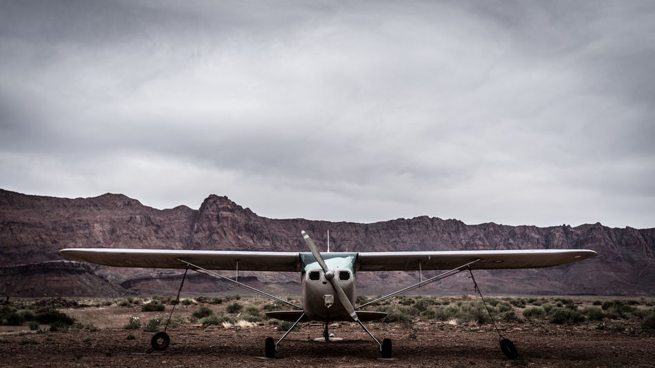 Desert EyeEm Best Shots EyeEm Gallery Old Fashioned Plane The Week On EyeEm Transportation Air Vehicle Aircraft Aircraft Wing Airplane Aluminium Cloud - Sky Desert Landscape Historic Landscape Metal Mode Of Transport Mountain Mountain Range Nature No People Outdoors Sky Transportation Lost In The Landscape