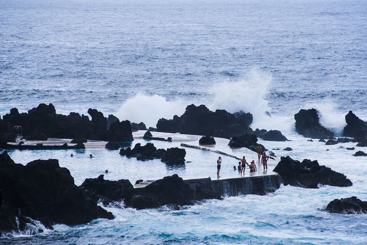 Natural lava swimming pool. Porto Moniz, Madeira island, Portugal. Atlantic Ocean Natural Lava Swimming Pool Porto Moniz Madeira Swimming Vacations Beach Beauty In Nature Eyeem Travel Lava Lava Rock Lava Swimming Pool Motion Nature One Person Outdoors Power In Nature Splashing Summer Swimming Pool Tourism Travel Destinations Warm Weather Water Water Splashes Wave