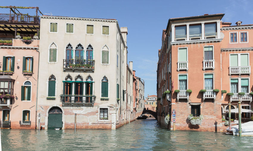 Venice, Italy - September 28, 2015 : Water channels of Venice city. Small channel Rio di San MArcuola departing from the Grand Canal in Venice, Italy. Architecture Building Canal City Cityscape Day Destination Europe Fasade Heritage Historic Holiday House Italy Landmark Old Outdoors Romantic Sea Tourism Travel Vacation Venice View Water
