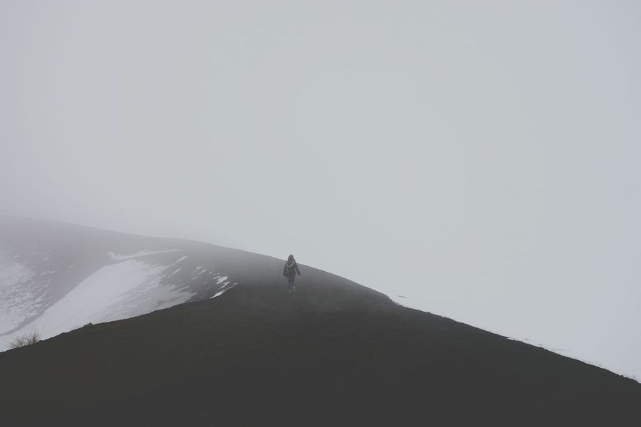 Little walk next to the crater Sicily Volcano Etna Volcano Travel Destinations Fog Outdoors One Person Snow Crater Crateri Silvestri Sony A6000 Walking On Lava The Way Forward