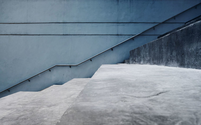 Empty Gray Concrete Staircase, Modern Cement Industrial Loft Style. Side View and Selective Focus, Interior or Exterior Design Concept Architecture Built Structure Wall - Building Feature No People Railing Direction Day The Way Forward Staircase Outdoors Steps And Staircases Building Exterior Concrete Wall Diminishing Perspective Connection Nature Absence Gray Footpath Empty Up Down Upstairs Cement
