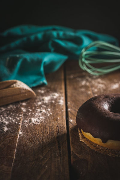 Chocolate Donut Art And Craft Blue Brown Close-up Craft Focus On Foreground Food Food And Drink Green Color Group Of Objects High Angle View Indoors  No People Selective Focus Still Life Studio Shot Sweet Food Table Temptation Textile Turquoise Colored Wood - Material