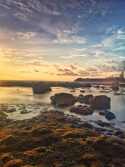 Sunset View on Rocky Beach Water Sky Sunset Sea Scenics - Nature Beauty In Nature Cloud - Sky Tranquility Beach Tranquil Scene Land Nature Rock Solid Orange Color No People Idyllic Non-urban Scene Rock - Object Outdoors