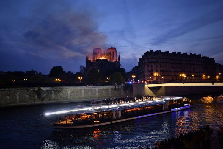 Large Group Of People Bateaux Mouches Tragedy Catastrophe Notre-Dame Is Burning Fire Incendie Water Architecture Built Structure Building Exterior Illuminated Cloud - Sky Night Travel Destinations