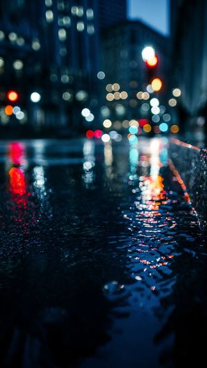 Surface level of wet street at night