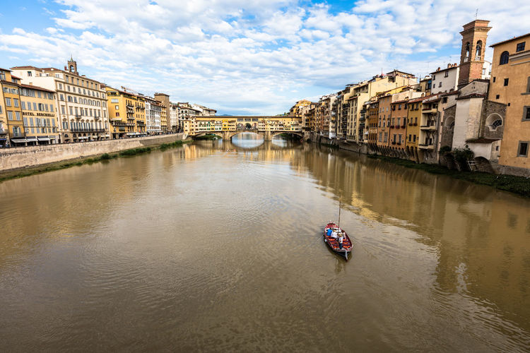 Architecture Boat Building Building Exterior Built Structure Canal City City Life Cloud Cloud - Sky Day Florence Leisure Activity Lifestyles Mode Of Transport Nautical Vessel Outdoors Rippled River Sailing Sky Tourist Travel Destinations Water Waterfront