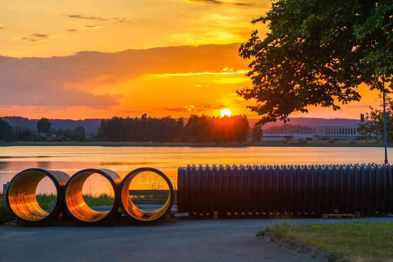 Tranquility. Sunset view of sewage pipes by the lake. 😊 Sewage Pipe - Tube EyeEm Gallery Sarpsborg Norway EyeEm Best Shots Lake Sunset Water Tree Sunset Rural Scene Agriculture Multi Colored Summer Sky Landscape Cloud - Sky Lakeside Countryside Idyllic Tranquil Scene Remote Scenics Calm Standing Water Waterfront Lakeshore