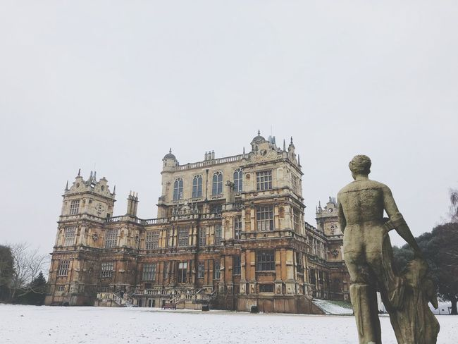 Wollaton Hall Winter Statue Snow Human Representation Cold Temperature Sculpture Male Likeness History Outdoors Building Exterior Architecture Low Angle View Built Structure