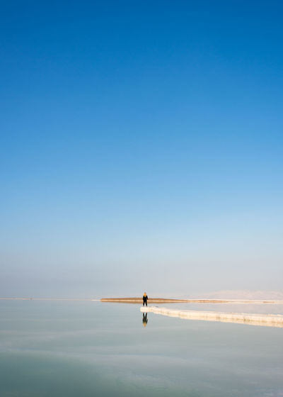 Minimalist Shooting Day At The Lowest Place On Earth -416 meters below sea level -Deadsea Israel Adventure Beauty In Nature Blue Clear Sky Deadsea Finding New Frontiers Golden Hour Israel Minimal Minimalism Minimalist Minimalobsession One Person Outdoors Reflection Reflection Reflections Salt Saltwater Tranquil Scene Tranquility Water EyeEm Team Rear View Getty X EyeEm Traveling Home For The Holidays Miles Away Long Goodbye An Eye For Travel