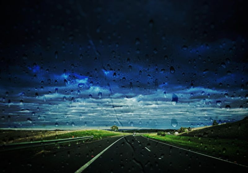 Roadtrip Road RainRoad Sky Clouds Driving Outdoors Rural Scene Landscape Travel Destinations Water Nature Horizon No People Beauty In Nature Highway Hills L4l The Great Outdoors - 2017 EyeEm Awards Lost In The Landscape
