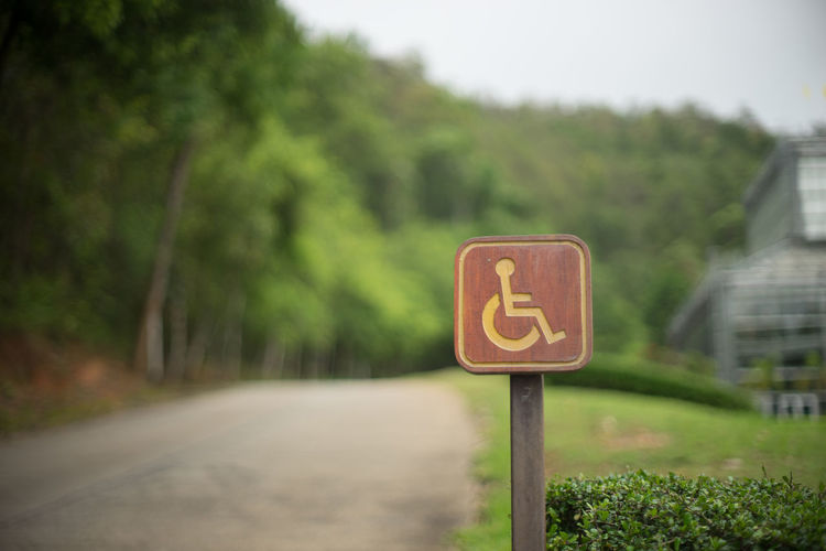 For Disable Person Lable Sign Close-up Day Directional Sign Disable Person Focus On Foreground Forbidden Green Color Growth Information Information Sign Lable Sign Nature No People Outdoors Plant Pole Road Road Sign Sky The Way Forward Tree Wood Lable Minimalist Architecture Art Is Everywhere Break The Mold TCPM The Photojournalist - 2017 EyeEm Awards Lost In The Landscape Be. Ready. Go Higher