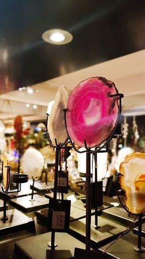 Close-up of wine glass against illuminated lights