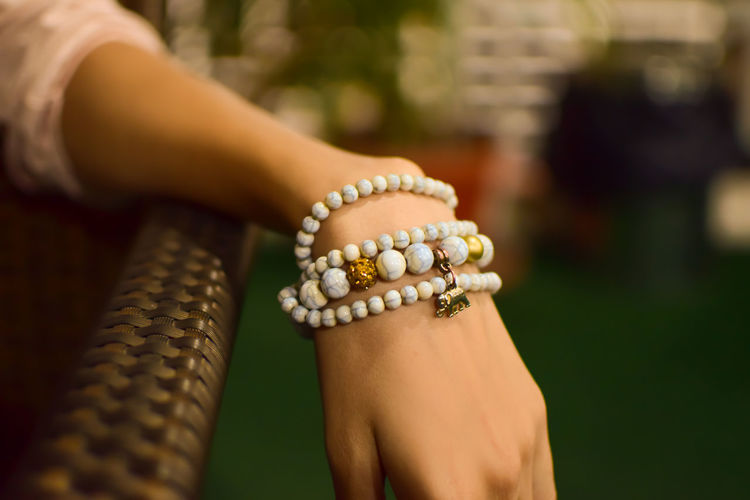 Cropped image of woman wearing bracelet