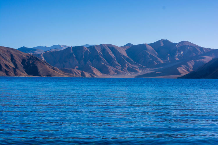 EyeEmNewHere Beauty In Nature Blue Clear Sky Copy Space Day Formation Idyllic Mountain Mountain Range Nature No People Non-urban Scene Outdoors Scenics - Nature Sea Sky Tranquil Scene Tranquility View Into Land Water Waterfront