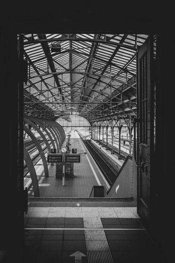 Railroad station platform seen through train