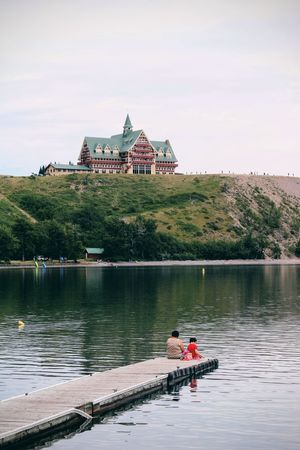 Architecture Built Structure Lake Travel Destinations Travel Sky History Outdoors Reflection Water People Day Vacations Building Exterior Landscape Nature Waterton Waterton National Park Hotel Prince Of Wales Hotel Alberta Waterton Lakes National Park Summer Scenics EyeEmNewHere Summer Road Tripping The Great Outdoors - 2018 EyeEm Awards