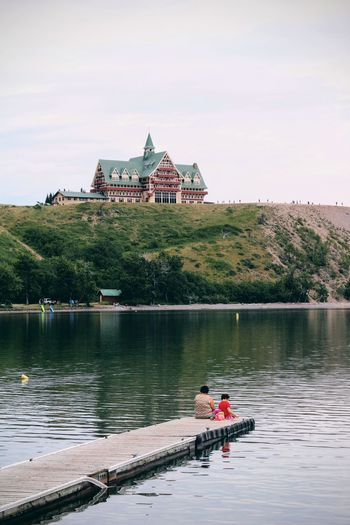 Architecture Built Structure Lake Travel Destinations Travel Sky History Outdoors Reflection Water People Day Vacations Building Exterior Landscape Nature Waterton Waterton National Park Hotel Prince Of Wales Hotel Alberta Waterton Lakes National Park Summer Scenics EyeEmNewHere