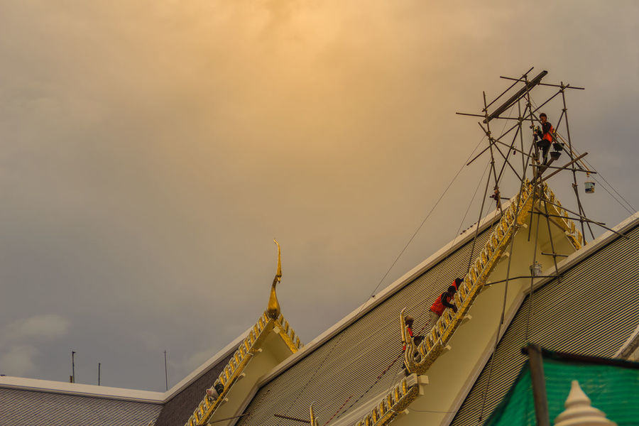 Chachoengsao, Thailand - May 12, 2017: Unidenitified workers during repair roof of the church in Wat Sothonwararam, a famous public temple in Chachoengsao Province, Thailand. Chachoengsao Chachoengsao Province Dramatic Sky Sothorn Wararam Worawiharn Temple WAT Sothon Wara RAM Worawihan (WAT Luang PHO Sothon) Wat Sothon Wat Sothon Wararam Worawihan Worker Worker And Tools Worker In Action Workers Dramatic Clouds Dramatic Light Dramatic Sunset Public Temple Repair Roof Sothon Wat Sothonwararam Worker At Work Worker Life Worker Tools Workers And Construction Workers Area Workers At Work