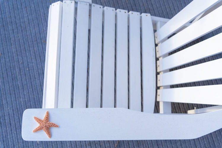 High angle view of artificial starfish on chair
