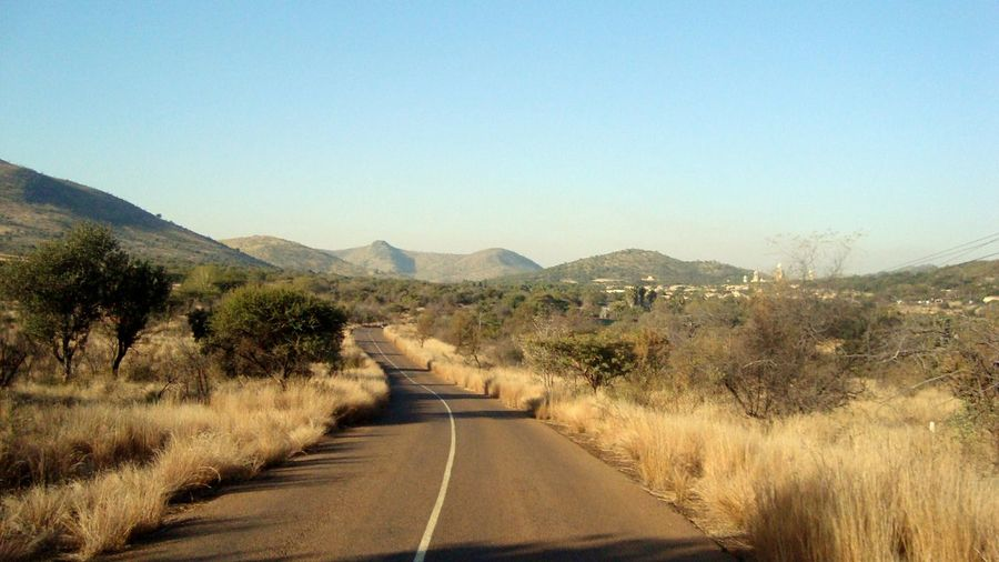 EyeEm Selects Pilanesberg National Park South Africa Road The Way Forward Mountain Clear Sky Day No People Outdoors Sky Nature Tree Colour Your Horizn Capture Tomorrow
