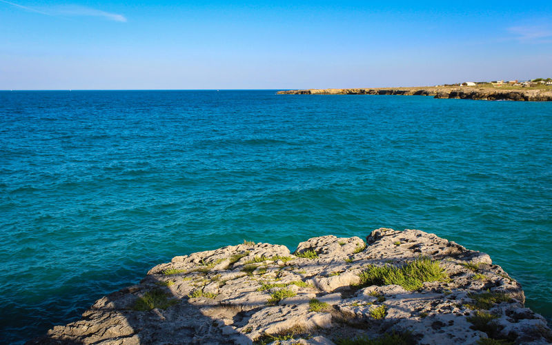 Puglia Beach Beauty In Nature Blue Clear Sky Day Groyne Horizon Horizon Over Water Italy Land Nature No People Outdoors Rock Rock - Object Rocky Coastline Scenics - Nature Sea Sky Solid Tranquil Scene Tranquility Water