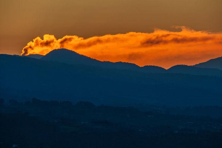 Turrialba Volcano erupting at daybreak, back=lit by the rising sun. Costa Rica Daybreak Mountains Nature No People Sunrise Sunrise Silhouette Turrialba Volcano