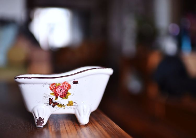 EyeEm Selects Focus On Foreground Indoors  No People Table Flower Close-up Freshness Flowering Plant Food And Drink Still Life Wood - Material Art And Craft Nature Day Plant Cup Floral Pattern White Color Food Tea Cup