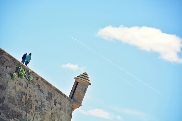 Tilt Shot Of Couple At Old Cathedral Of Lleida Against Sky