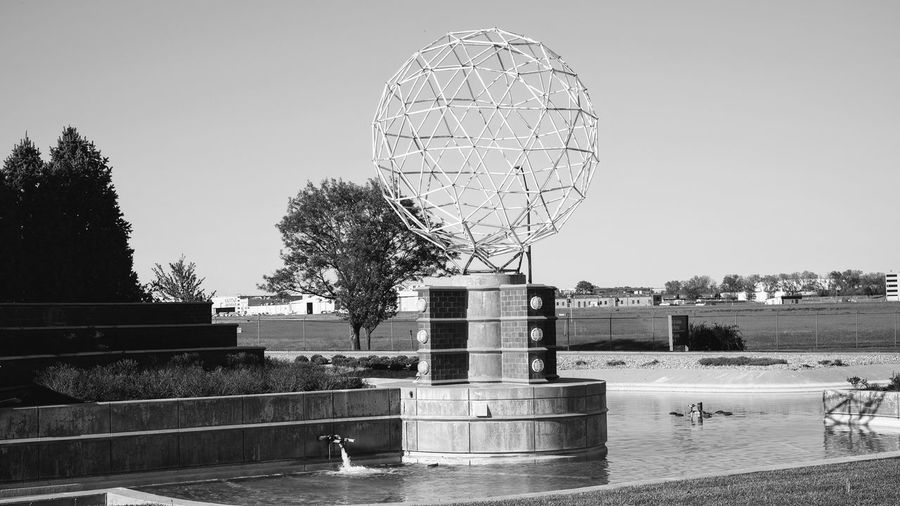 Lincoln, Nebraska May 5, 2017 Airport Architecture Black And White Blackandwhite Buckminster Fuller Built Structure Clear Sky Day Foutain Geodesic Icosahedral Symmetry No People Outdoors Polyhedron Sculpture Sky Water Zome Tool