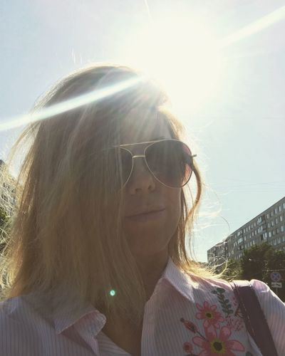 Summer time 🌞🔥 Summer Headshot Sunlight Glasses Real People Lifestyles Portrait One Person Fashion Nature Long Hair Young Adult Leisure Activity Sunglasses Young Women Lens Flare Front View Sunbeam Hair Sky Hairstyle