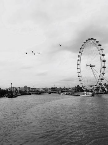 Ferris Wheel Sky Architecture Flying Built Structure Amusement Park Ride Building Exterior Travel Destinations Water Cultures Bird Amusement Park Outdoors City Day No People Nature Big Wheel London London Eye Lynx Helicopter IPhone Photography EyeEm Best Shots EyeEmBestPics IPhoneography