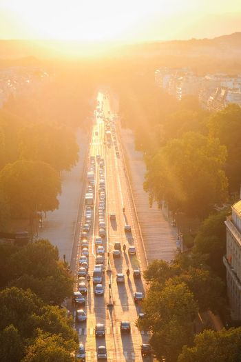 High angle view of vehicles on road at sunset
