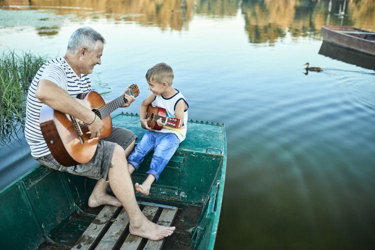 Boy sitting in lake