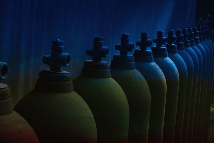 Close-up of bottles in row