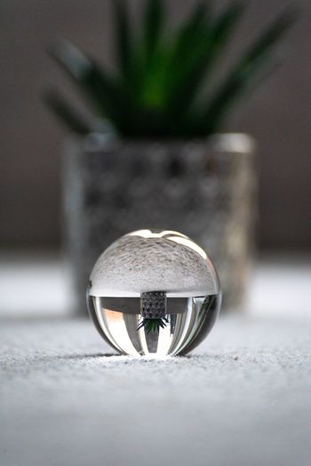 Close-up of crystal ball on metal