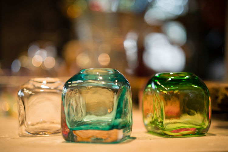 Close-up of glass cubes on table