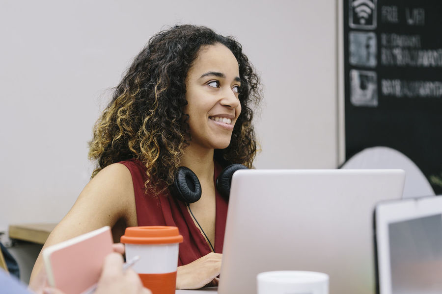 African-american Casual Clothing Complicity Coworking Discussion English Eurepean European  Happy Headphones Laptop Meeting Mixed Race Multiethnic Notebook Office Smile Social Networks Startup Teamwork Technology Work Modern Workplace Culture